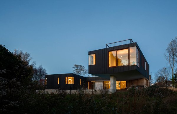 Rear of the House hovering over the wetlands. Photo  of Watermill House modern home