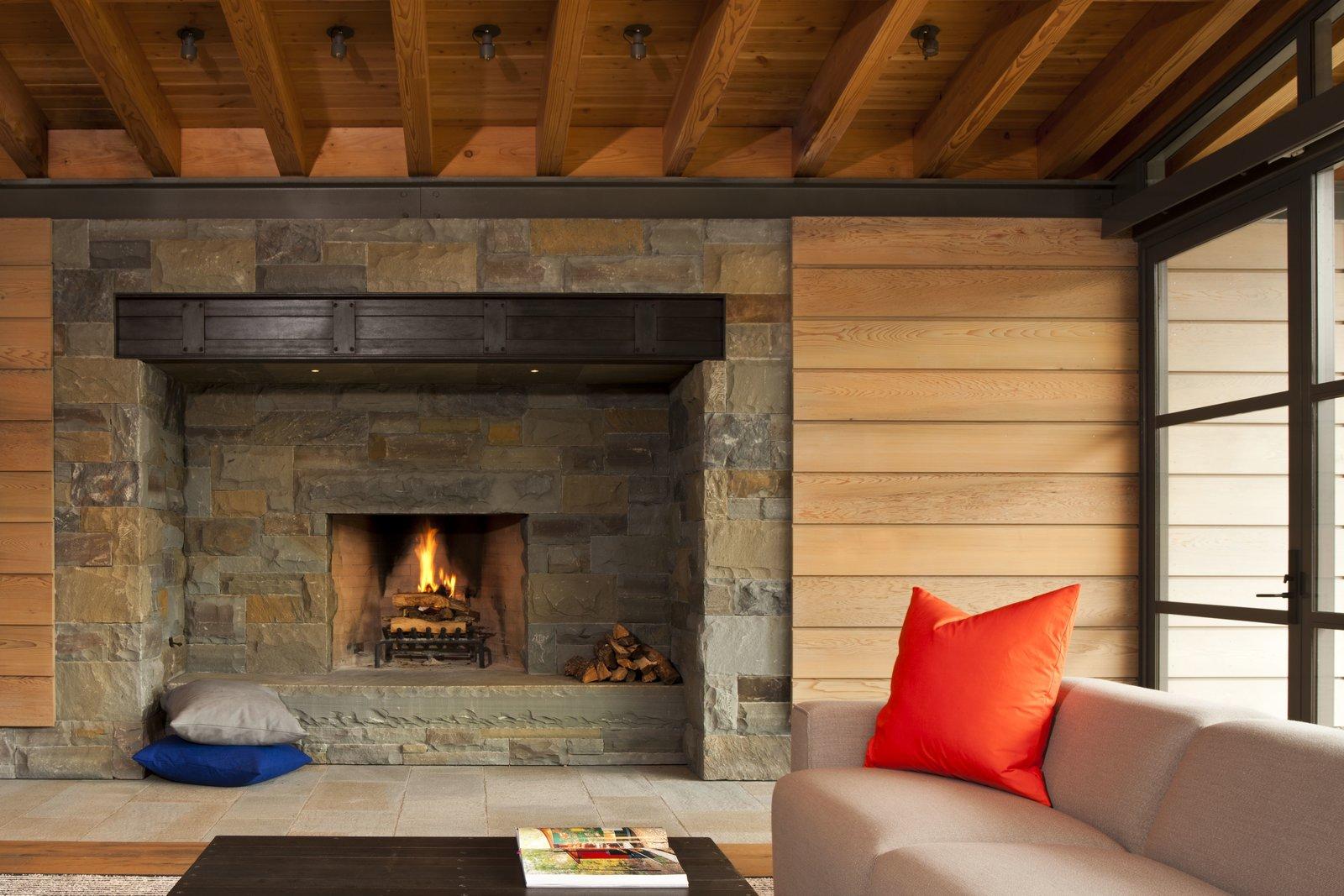 Tagged: Living Room, Wood Burning Fireplace, Coffee Tables, Light Hardwood Floor, and Sectional.  Halls Ridge Knoll by Bohlin Cywinski Jackson