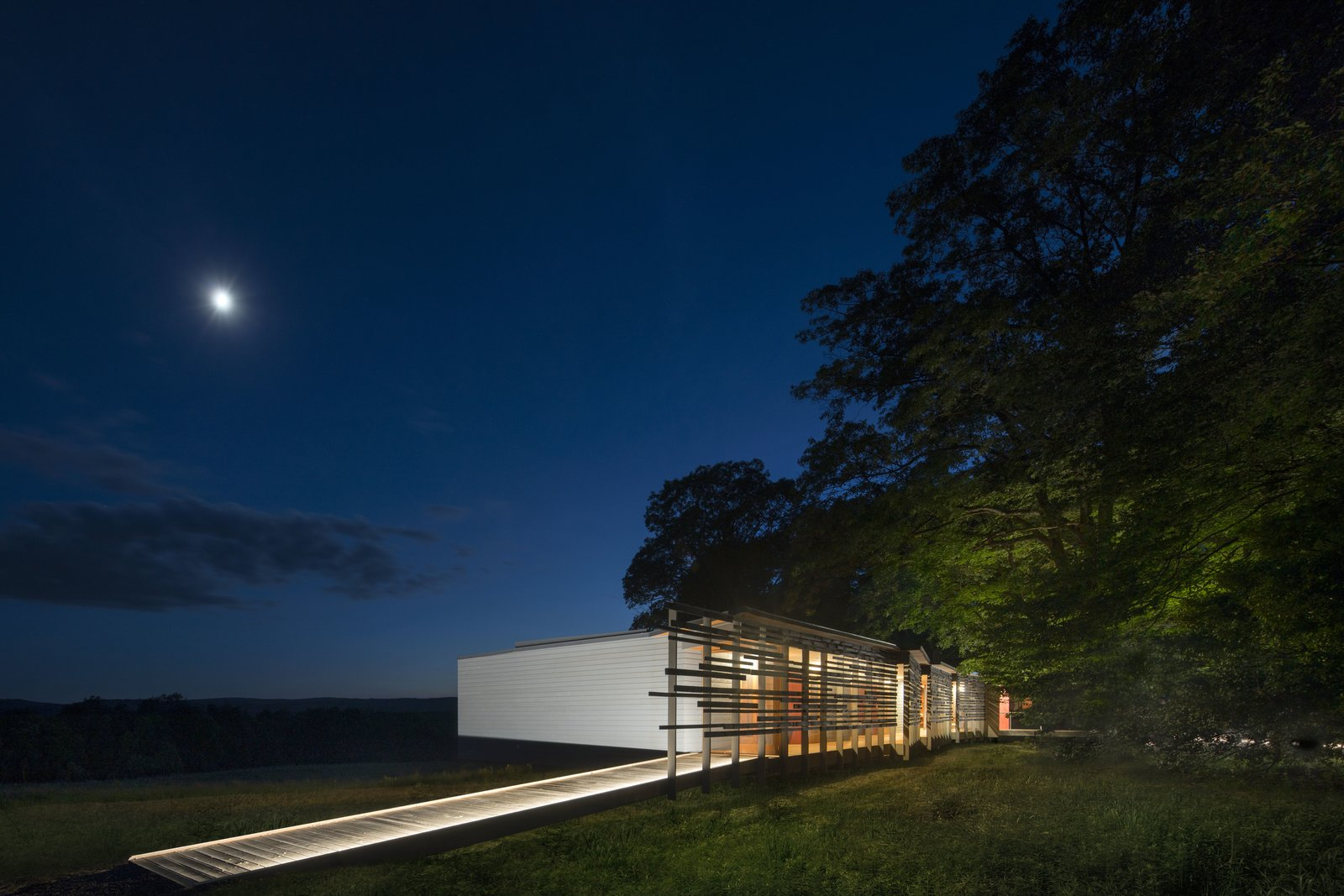 Tagged: Outdoor, Trees, Side Yard, Decking Patio, Porch, Deck, and Grass.  High Meadow at Fallingwater by Bohlin Cywinski Jackson