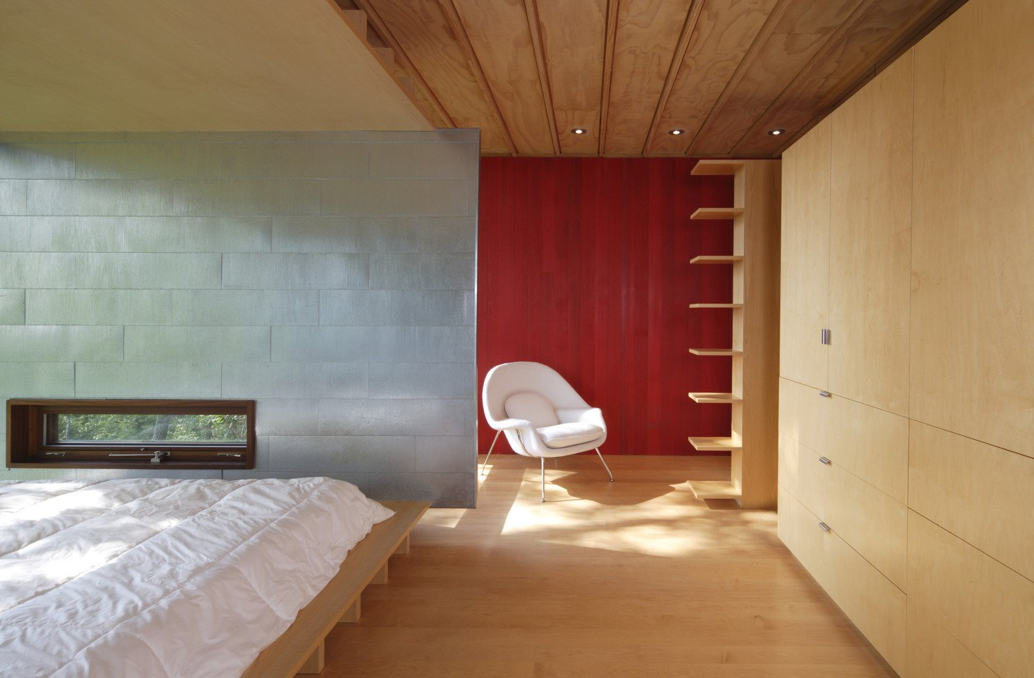 Tagged: Bedroom, Light Hardwood Floor, Storage, Bed, and Chair.  Edge House by Bohlin Cywinski Jackson