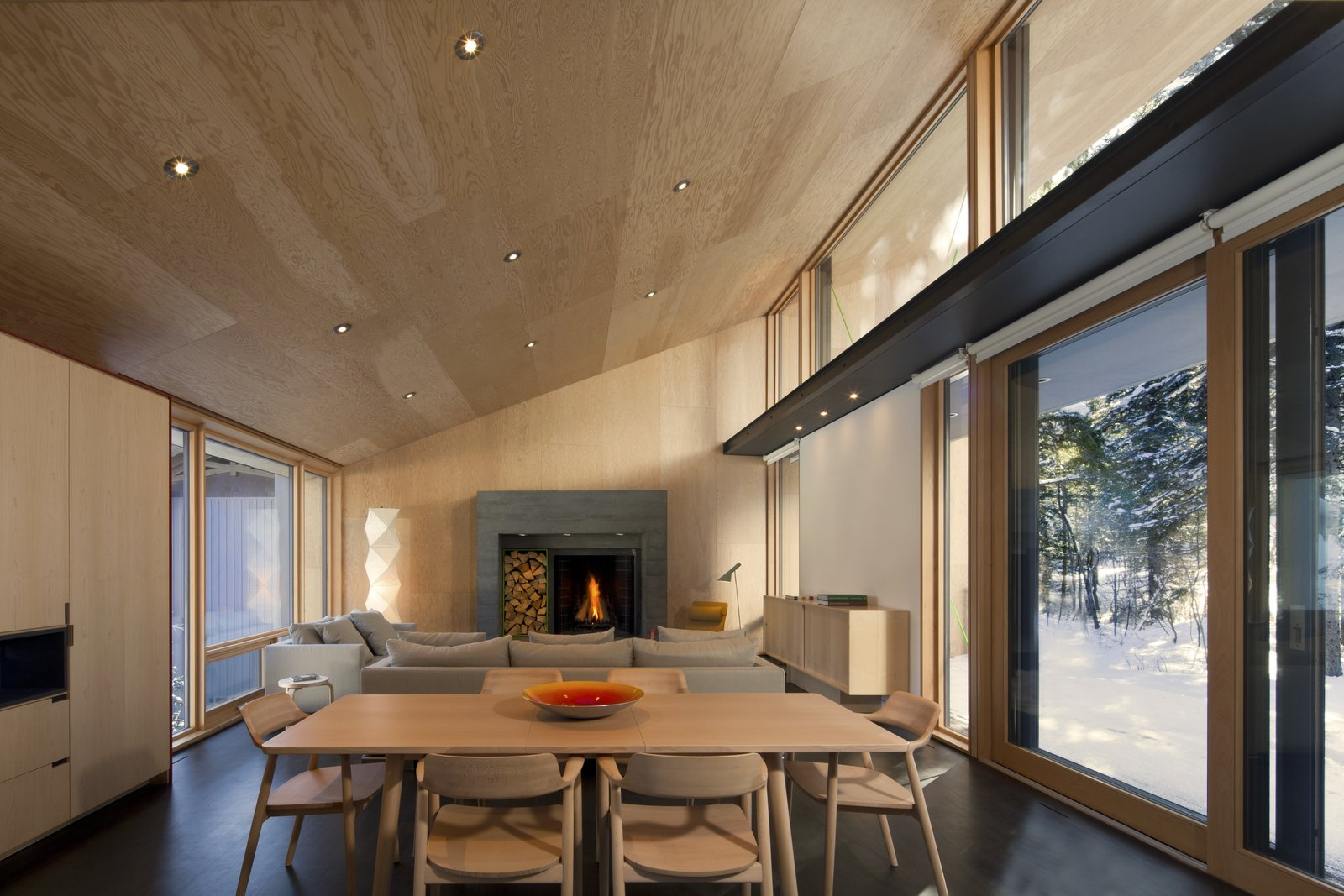 Tagged: Wood Burning Fireplace, Table, Chair, Living Room, and Recessed Lighting.  Kicking Horse Residence by Bohlin Cywinski Jackson