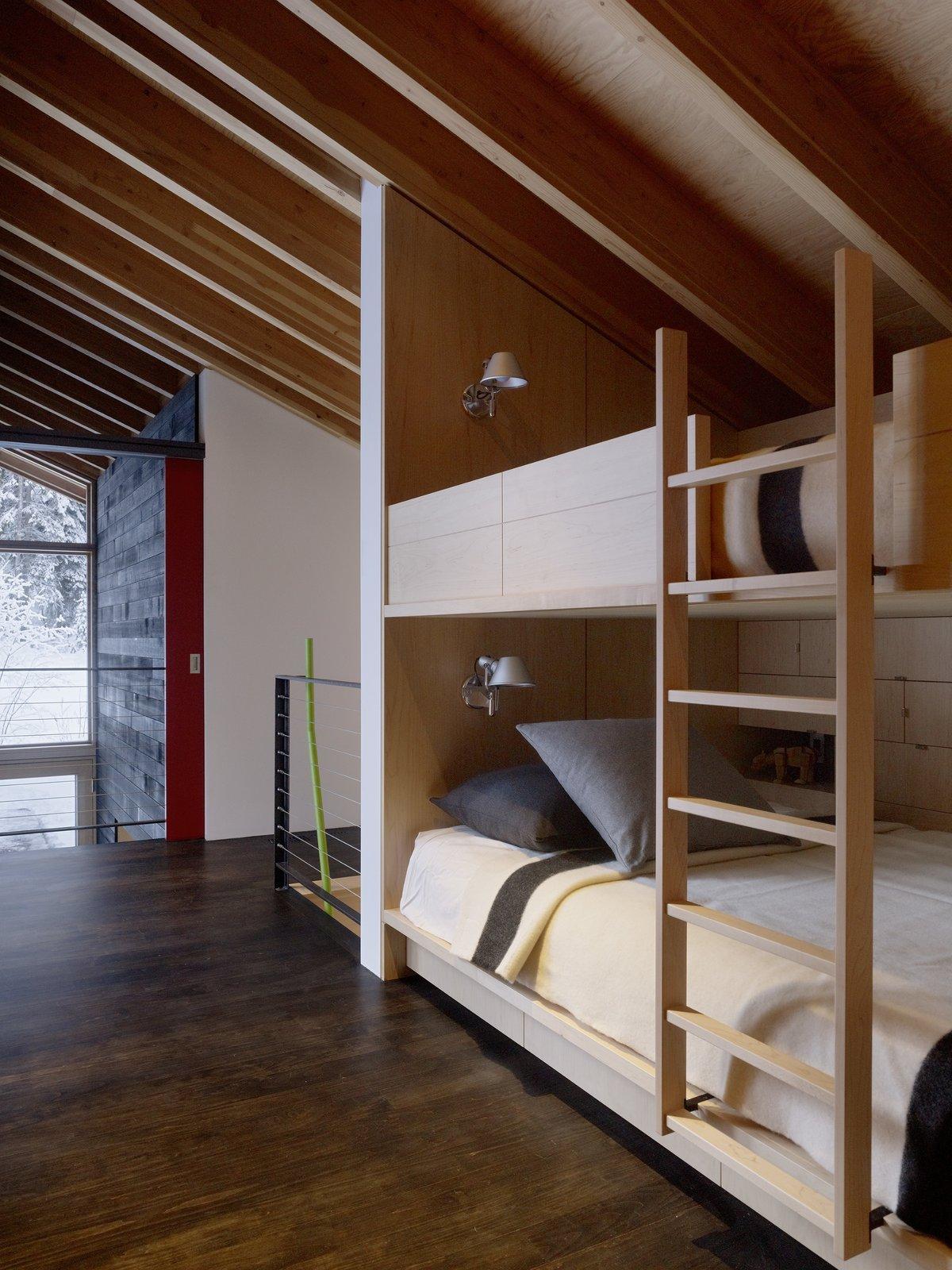 Tagged: Bedroom, Bunks, Wall Lighting, and Dark Hardwood Floor. Kicking Horse Residence by Bohlin Cywinski Jackson