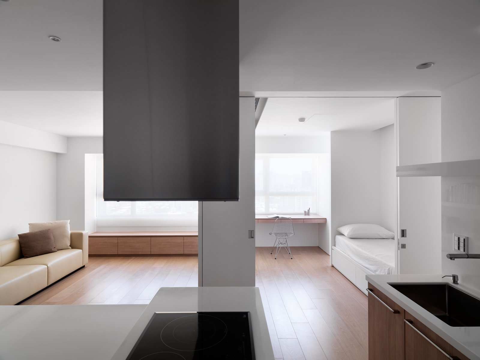 The entire apartment is one singular continuous space.  KT Apartment by Marty Chou Architecture