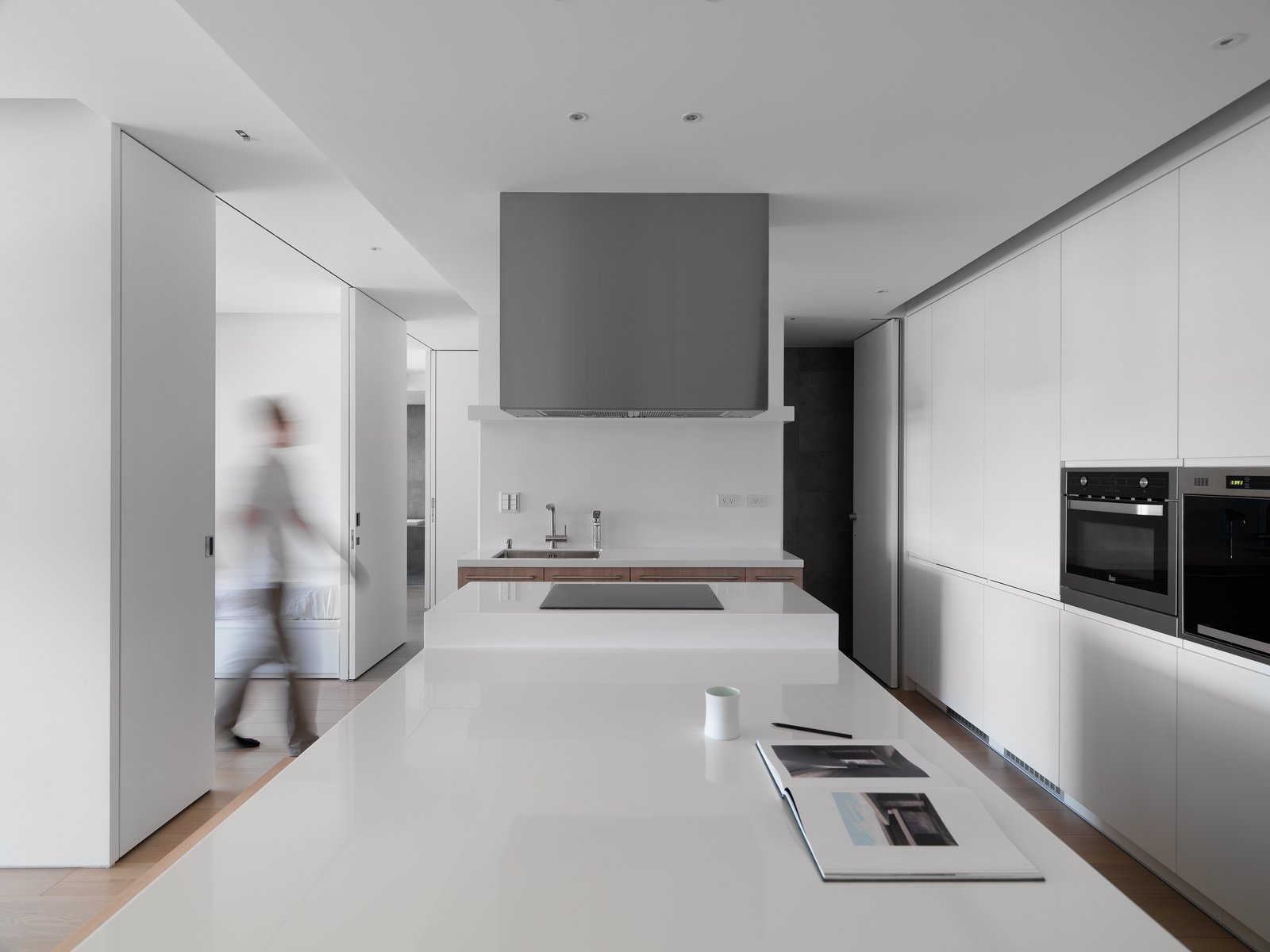 Spacious table top serves as cooking, dinning, and working surface.  KT Apartment by Marty Chou Architecture