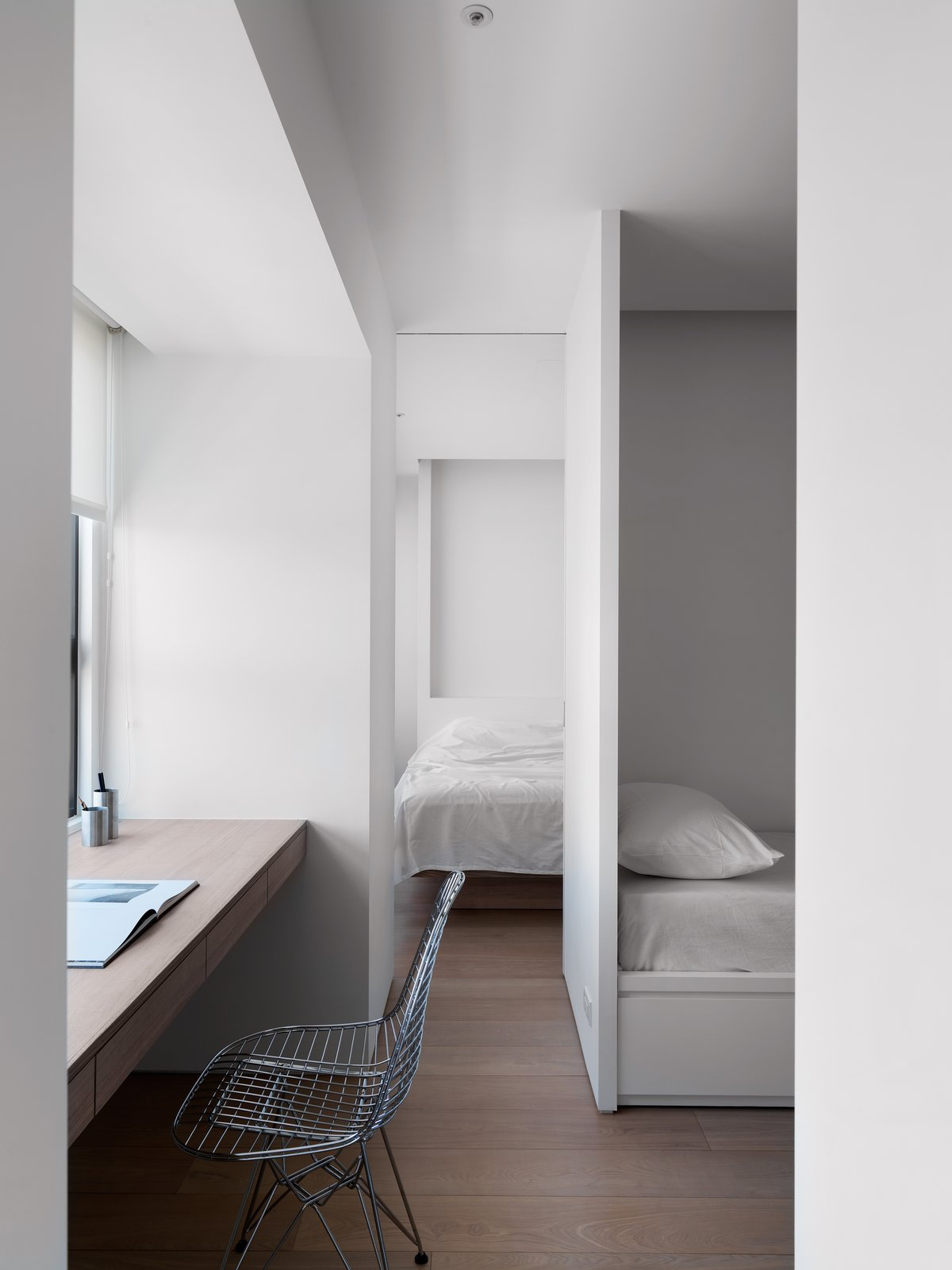 The recess(or alcove)  give a sense of expansion of space. KT Apartment by Marty Chou Architecture