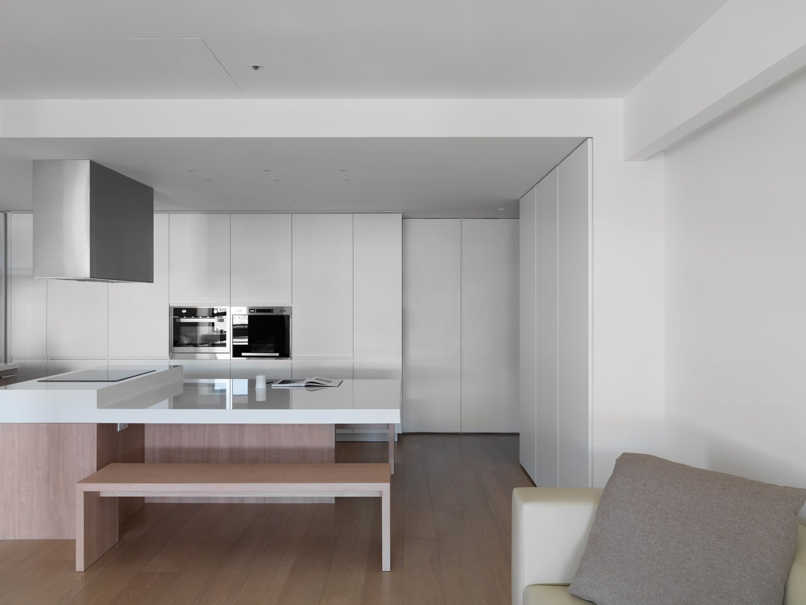 There are storage throughout the entire apartment, but its appearance is reduced to simple line that adds rhythm to the space. KT Apartment by Marty Chou Architecture