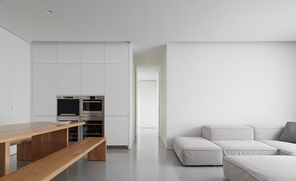 A  neutral ambience that captures the basic living quality: light, space, and materiality. Photo  of The Element Apartment modern home