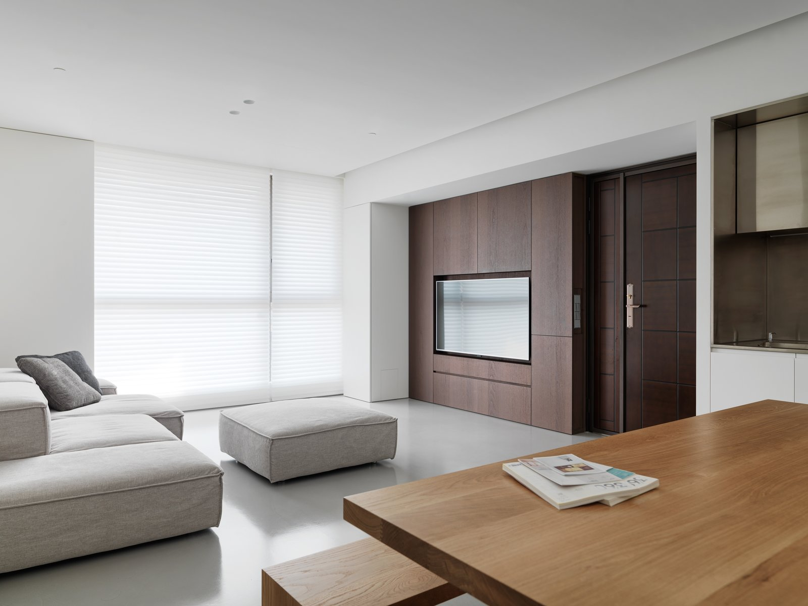 Wood and fabric are selected to punctuate or merge with the space.