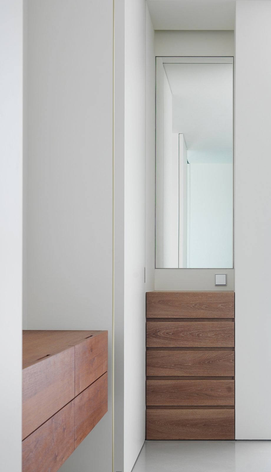 Hidden Vanity  The Element Apartment by Marty Chou Architecture