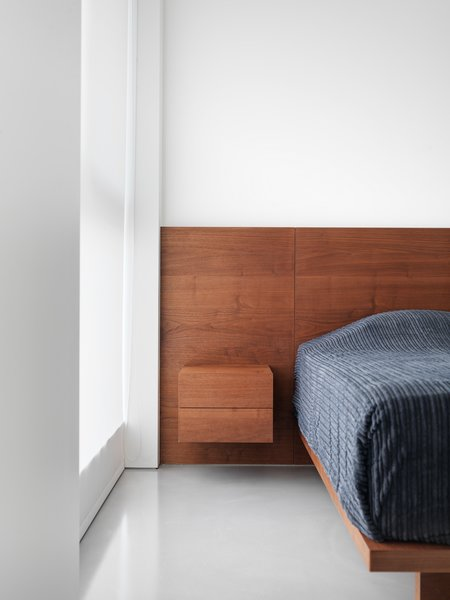 Wood and fabric are selected to punctuate the space and to provide warmth and intimacy. Photo 6 of The Element Apartment modern home
