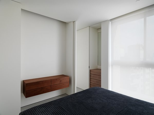 Doors are set not only to divide rooms but to unite space; when opened, the full height panels disappear and make the entire unit one continuous whole. Photo 4 of The Element Apartment modern home