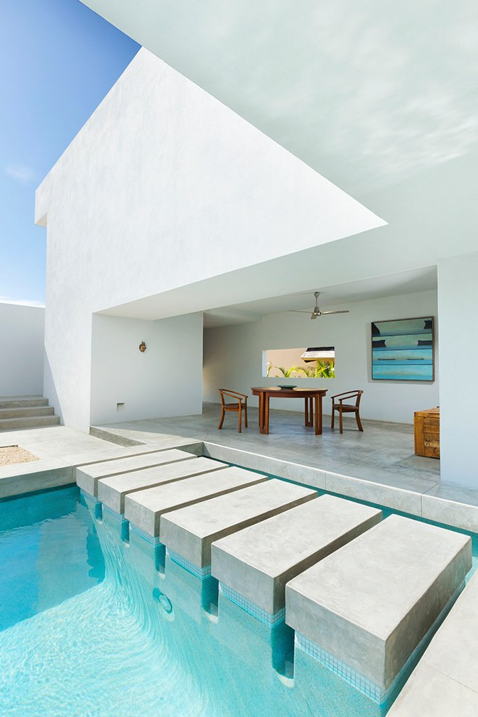 Designed by Campos Leckie to invoke a pure, dream-like quality, this minimalist retreat is situated on a hill above Zippers Beach overlooking the Sea of Cortez. The bold geometric angles, stripped down interior, and whitewashed walls allow for maximum light and shadow play throughout the day. The home features a Zen garden, central pool, and a rooftop patio with sweeping views of the ocean and mountains.