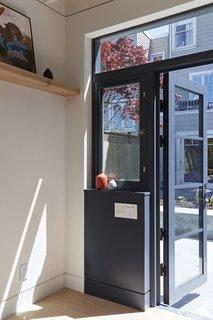 An Unused Garage Is Transformed Into a Light-Filled Backyard Studio - Photo 4 of 9 -