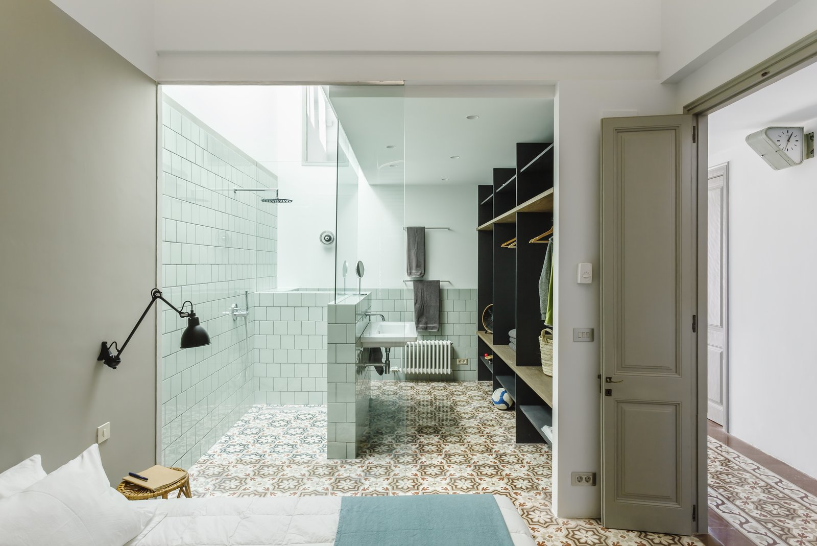 Tagged: Bath, Ceramic Tile, Wall Mount, Open, and Porcelain Tile.  Best Bath Ceramic Tile Wall Mount Photos from A Careful Renovation Brings New Life to a Family's Heritage Home on the Spanish Coast
