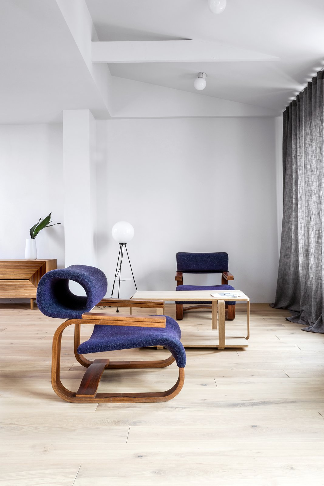 Armchair designed by Jan Bocan (1972) Tagged: Living Room, Coffee Tables, and Chair.  Photo 2 of 12 in A Family's Loft in Poland Gets a Minimalist Renovation That's Both Elegant and Functional