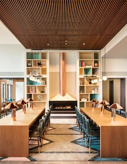 """Tour a New Residential High-Rise That's Uniquely """"Chicago"""" - Photo 4 of 11 - The Living Library is anchored by a copper fireplace."""