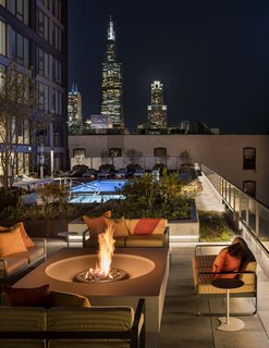"""Tour a New Residential High-Rise That's Uniquely """"Chicago"""" - Photo 10 of 11 - Fire pit and pool area"""