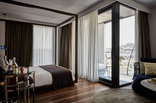 A New Hotel That Celebrates Ibiza's Maritime History and Love For Parties - Photo 5 of 11 -