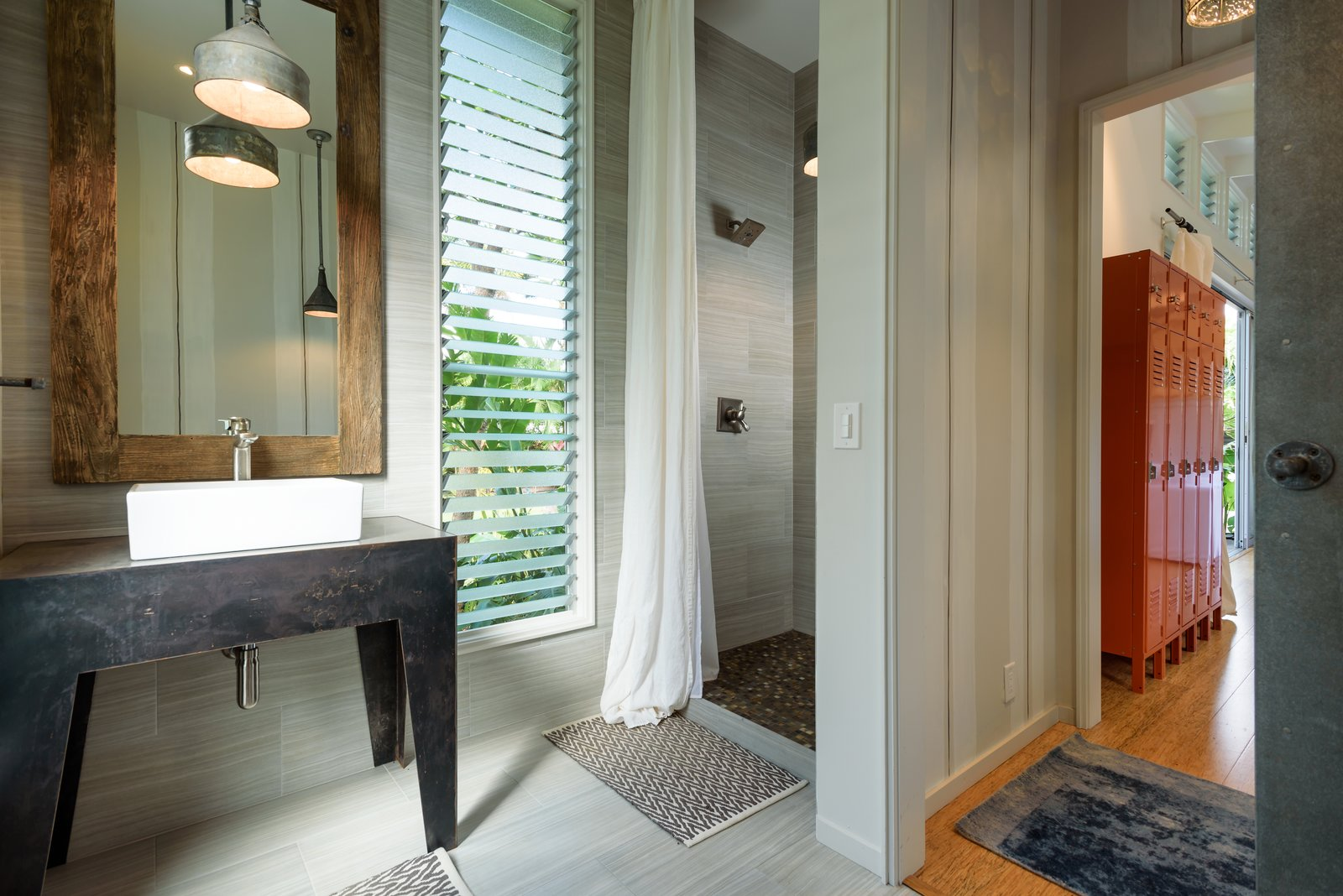 Tagged: Bath Room, Ceramic Tile Floor, Pendant Lighting, Drop In Sink, and Corner Shower.  Photo 7 of 13 in A Renovated Hawaiian Beach House From the 1950s Asks $1.79M