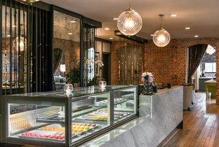 This Group Is Reimagining the Future of Boutique Hotels - Photo 7 of 14 - A candy counter greets hotel guests as a subtly elegant nod to the building's history.