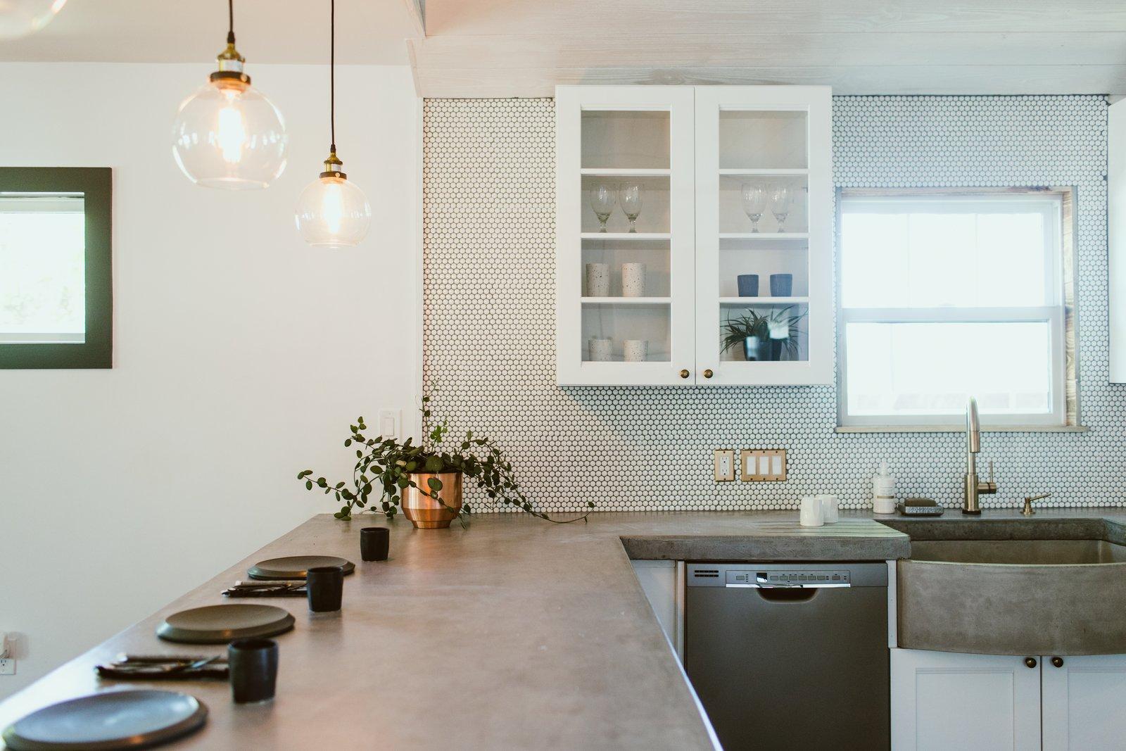 Tagged: Concrete Counter, White Cabinet, and Ceramic Tile Backsplashe.  Gullett House by Jeanne Schultz Design Studio