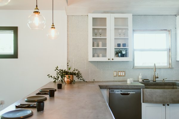 Modern home with concrete counter, white cabinet, and ceramic tile backsplashe. Photo 3 of Gullett House