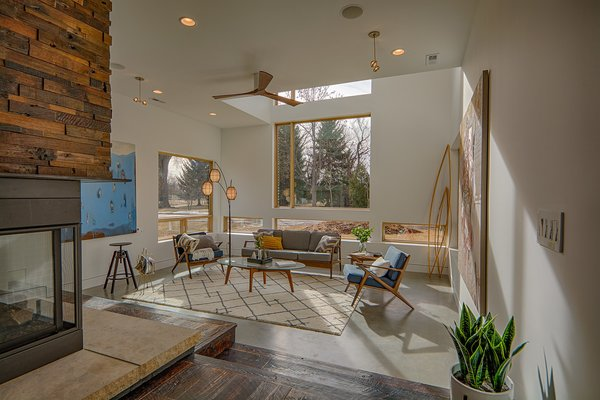 "Sunken Living room with concrete floors to allow for solar passive heat. Danish Mid-century Modern minimalist furniture highlighting the motto "" Less is More."" Photo 2 of Modern Barn Revival modern home"