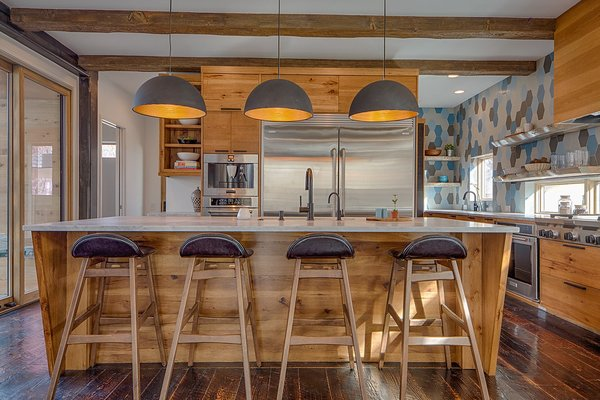 Full Chef's Kitchen to include a Commercial side-by Side Fridge/Freezer and Espresso maker. There are double ovens and double dishwashers with a walk in pantry. Motion sensor LED lighting under toe-kicks. Photo 4 of Modern Barn Revival modern home