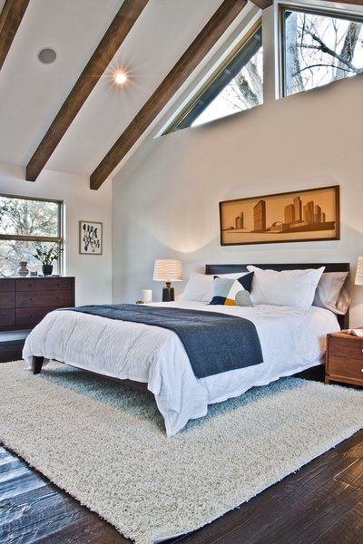 Master retreat has vaulted ceilings with patio deck for views of golf course and city park. Photo 8 of Modern Barn Revival modern home