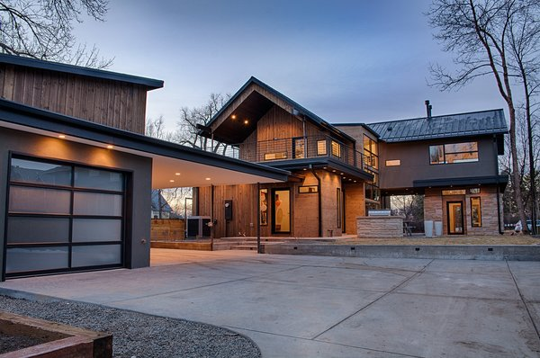 Detached garage, outdoor grill and patio, perfect for summer entertaining.  Photo 11 of Modern Barn Revival modern home