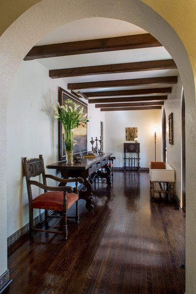 Hand painted tiles trim archways and openings, while the original hardwood flooring and light fixtures compliment the exuberant display of art and architecture. Photo 10 of Casa Comodoro modern home