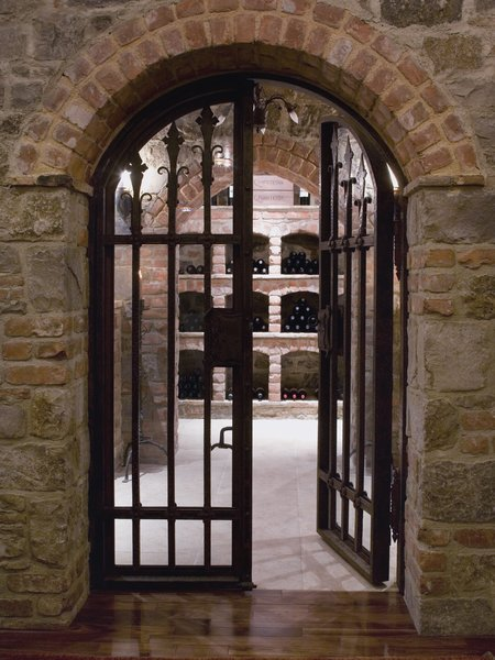 This custom temperature controlled wine cellar was once part of a speakeasy but now houses a private collection of wines. Photo 14 of Casa Comodoro modern home