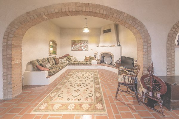 Recycled bricks from a former home frame the arched windows Photo 5 of underground house modern home