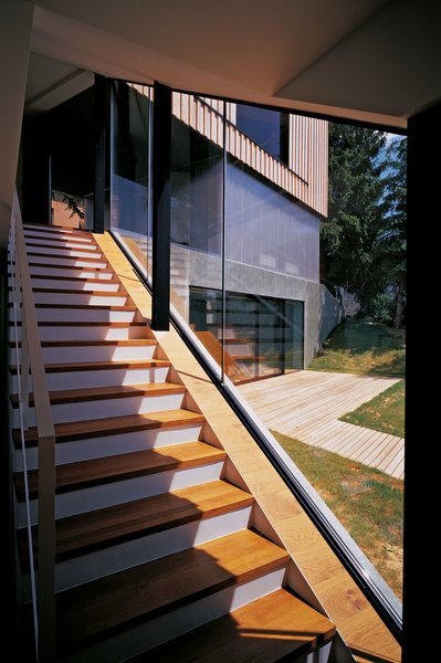 Stairs that connect the ground floor and basement floor Photo 6 of House J2 modern home
