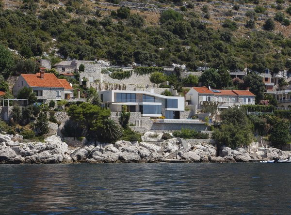 View of the house from the sea Photo  of House V2 modern home
