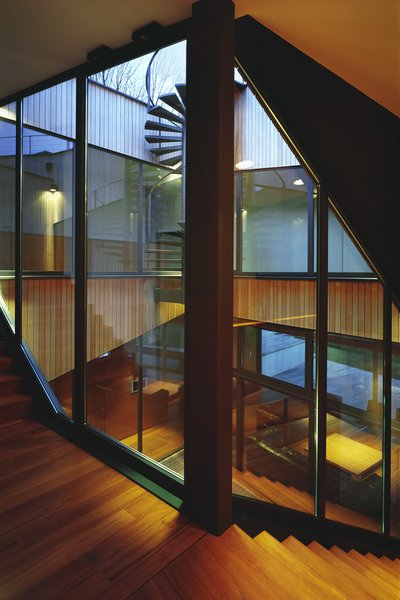 Atrium in the center of the house, and the staircase that winds around it Photo 8 of House K modern home