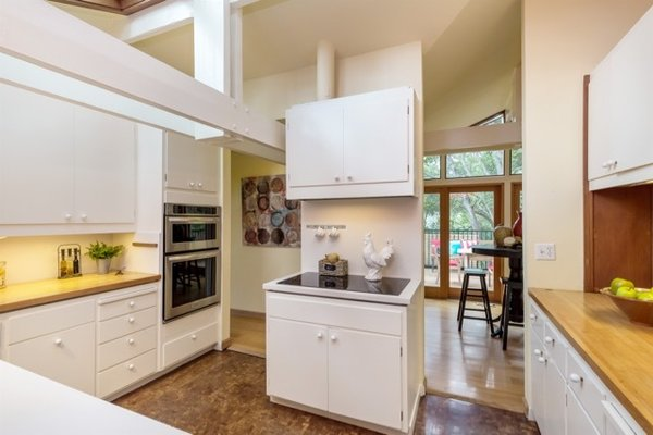 Modern home with kitchen, engineered quartz counter, wood counter, white cabinet, and dark hardwood floor. Photo 15 of Nuovo Mondo - Los Gatos Treehouse
