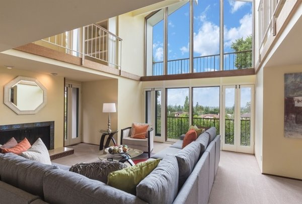 Modern home with living room, wood burning fireplace, marble floor, carpet floor, and ceiling lighting. Photo 5 of Nuovo Mondo - Los Gatos Treehouse