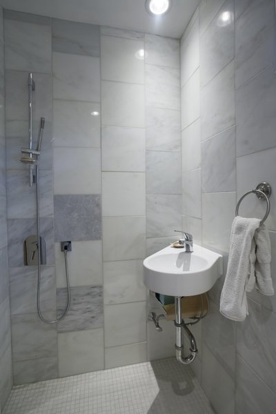 The entrance way also doubles as a mud room with a shower wet room. Photo 6 of The Bath House modern home