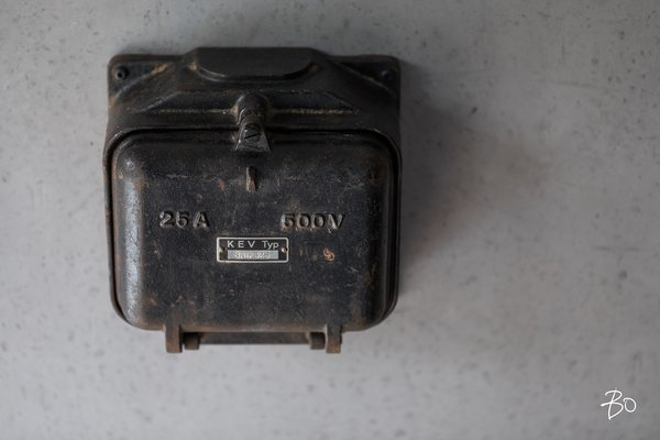 An old electrical junction box found from a local junk yard, which now encases an intercom / electronic door opener Photo 16 of villAma modern home