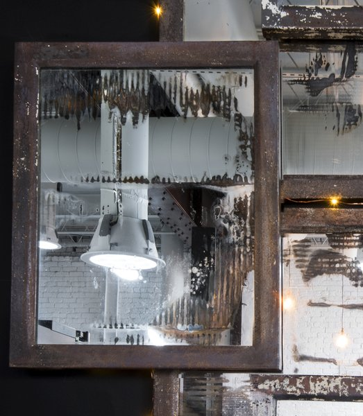 Detail of vintage mercury mirror installation made from medicine chests collected from historic Birmingham Hotel renovation.  Made by the Funktion Art Design Compound, a local collective that up-cycles and re-imagines architectural accents. Photo 9 of Studio GoodLight modern home