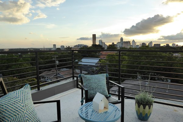 Modern home with outdoor, rooftop, hardscapes, large patio, porch, deck, concrete patio, porch, deck, and metal fence. View from rooftop deck towards downtown Austin Photo 9 of East 9th House