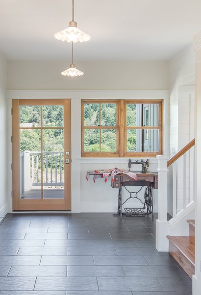 Timeless materials such as slate flooring, hardwood doors and windows define the home's entry.   Photo 3 of Shadowood House modern home