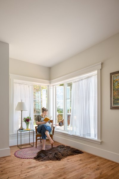 A reading nook, furnished with corner casement windows, welcomes an unexpected guest. Photo 8 of Shadowood House modern home
