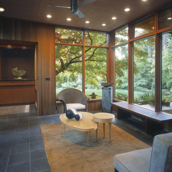 The sitting room enjoys views towards the lush garden beyond.   Photo 3 of Belluschi Addition modern home