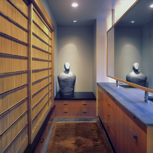 The Master Bath incorporates a changing area with ample storage and a series of antique Japanese sliding screens. Photo 8 of Belluschi Addition modern home