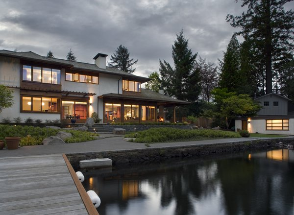 Built with timeless materials - stone, plaster and a range of woods - this house reflects regional Pacific Northwest design. Sited along Lake Oswego, this home's views, boathouse and terraces all gracefully connect to the water's edge. Photo  of Lakeside House modern home