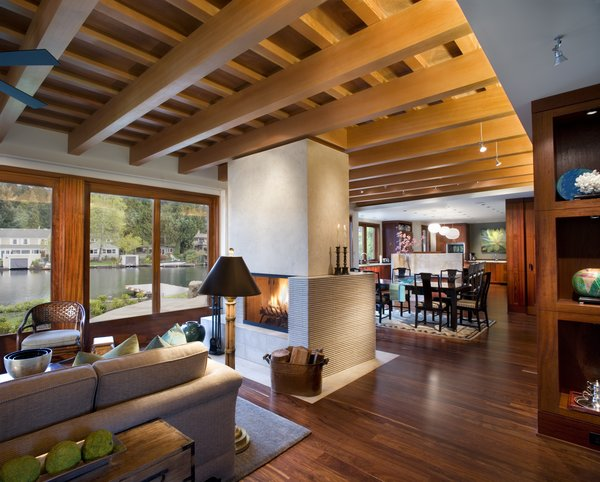 The Great Room sits below a lattice of Douglas Fir beams.  Mahogany floors and casework evoke the traditional materials of Pacific Rim architecture.  Photo 4 of Lakeside House modern home