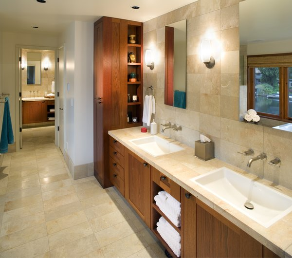 The Master Bath features luxurious materials of Mahogany wood and natural stone. Photo 5 of Lakeside House modern home