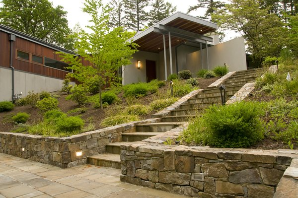 Low basalt stone walls lead to the home's entry at the upper terrace.  Photo 2 of Cedar Mills House modern home